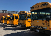 photo of school buses at the yard