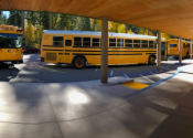 image of school buses in bus loading zone