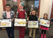 This is a photo of three of the school bus poster contest winners from last year
