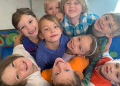 photo of a group of smiling kinders from above from Donner Trail Elementary School