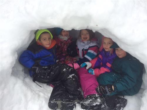 Children inside snow cave for Winter Survival