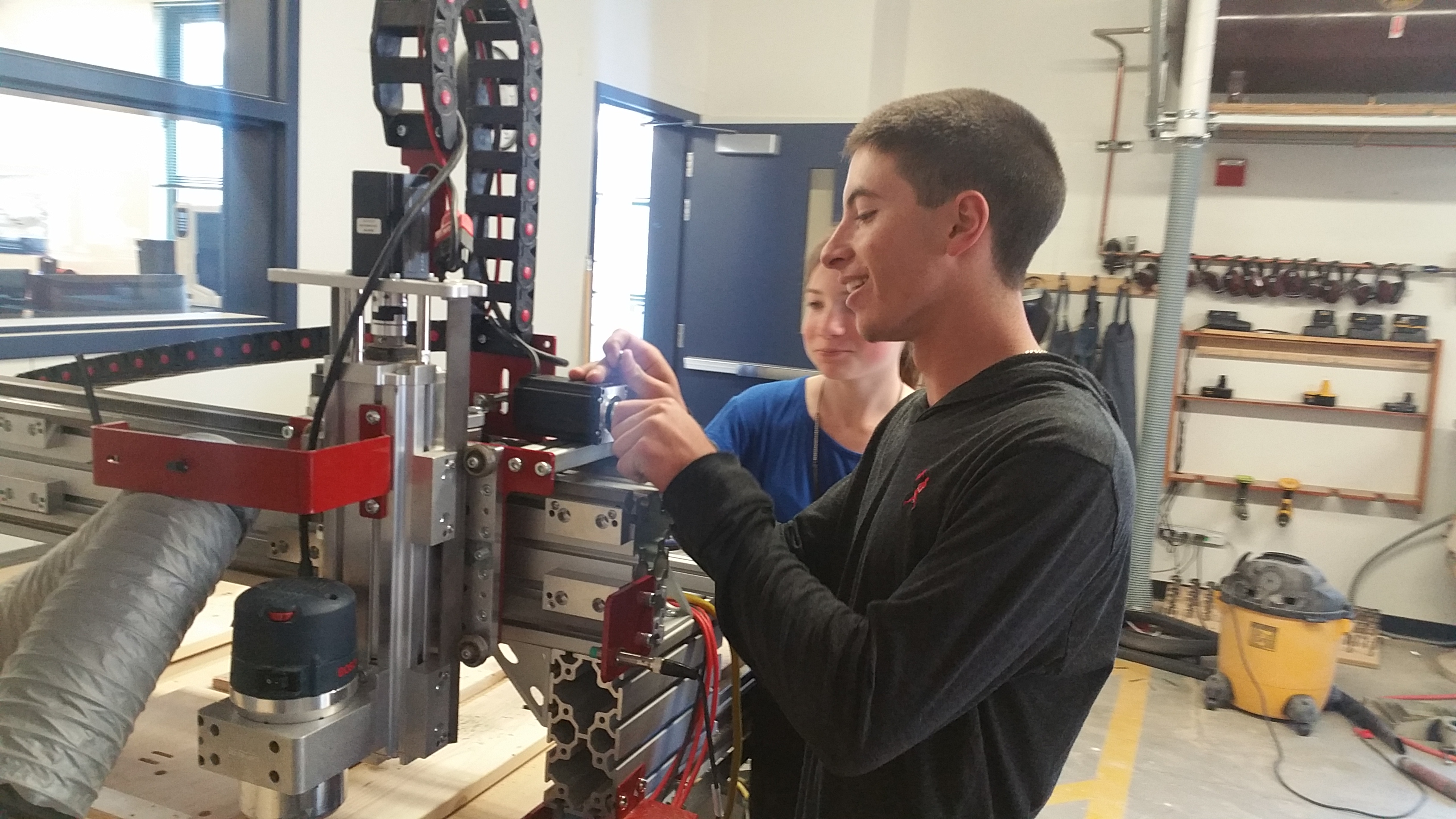 Engineering students at NTHS working on a machine
